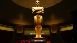 This Feb. 21, 2015 file photo shows an Oscar statue as preparations are made for the 87th Academy Awards in Los Angeles. The 89th Academy Awards will be held on Sunday. (Photo by Matt Sayles/Invision/AP, File)
