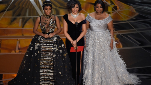 Janelle Monae, from left, Taraji P. Henson, and Octavia Spencer present the award for best documentary feature at the Oscars on Sunday, Feb. 26, 2017, at the Dolby Theatre in Los Angeles. (Photo by Chris Pizzello/Invision/AP)