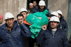 "FILE - In this Sept. 16, 2015 file photo, comrades carry Ilias Mahmoud al-Taweel, a member of Syrian Civil Defence, popularly known as the White Helmets, during his funeral in in Douma, Syria. Raed Saleh, the head of the Syrian search-and-rescue group featured in the Oscar-winning Netflix documentary ""The White Helmets,"" said the award is an inspiration and a huge moral support for the volunteers to keep up their mission in the war-torn country. Saleh also appealed on governments around the world ""to stop the bloodshed of the Syrian people."" (Feras Domy via AP, File)"
