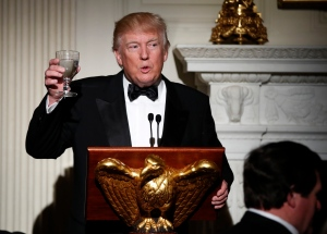 Host President Donald Trump, makes a toast during a dinner reception for the annual National Governors Association winter meeting Sunday, Feb. 26, 2017, at the State Dining Room of the White House, in Washington. (AP Photo/Manuel Balce Ceneta)