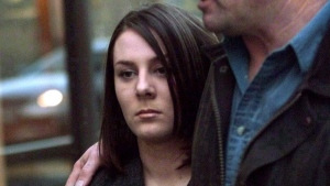 Kelly Ellard and her father Lawrence leave the Vancouver courthouse, March 30, 2000. THE CANADIAN PRESS/ Adrian Wyld