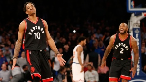 Toronto Raptors guard DeMar DeRozan (10) and forward P.J. Tucker (2) celebrate after DeRozan hit a turnaround jumper in the waning seconds of the fourth quarter of an NBA basketball game against the New York Knicks at Madison Square Garden in New York, Monday, Feb. 27, 2017. DeRozan's 37 points led the Raptors to a 92-91 victory over the Knicks. (AP Photo/Kathy Willens)