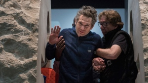 French artist Abraham Poincheval waves as he exits the two halves of the rock in which he has been been entombed, in Paris, Wednesday, March 1, 2017. Abraham Poincheval emerged Wednesday from a 12-tonne limestone boulder at a Paris art gallery where he has been entombed since Feb. 22. (AP Photo/Zacharie Scheurer)