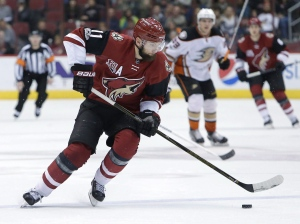 In this Feb. 20, 2017, file photo, Arizona Coyotes center Martin Hanzal (11) moves with the puck during the team's NHL hockey game against the Anaheim Ducks in Glendale, Ariz. The NHL trade deadline is looming over the league, leading to players such as Detroit Red Wings defenseman Brendan Smith and forward Thomas Vanek wondering if they will be dealt. Both players have expiring contracts, making them attractive on the market, along with Arizona's Hanzal, Dallas' Patrick Eaves and Tampa Bay's Ben Bishop. (AP Photo/Rick Scuteri, File)