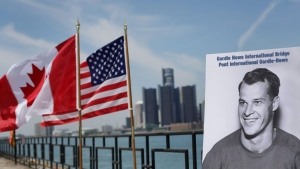 A photograph of Gordie Howe is displayed on the riverfront after a news conference, Thursday, May 14, 2015, in Windsor, Ontario, announcing that a planned bridge connecting Detroit, rear, and Windsor, will be named after the hockey Hall of Famer. THE CANADIAN PRESS/AP-Romain Blanquart/Detroit Free Press via AP, Pool