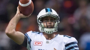 Toronto Argonauts' Ricky Ray looks for an open receiver before throwing the ball out of bounds during the first half of a CFL football game against the B.C. Lions in Vancouver, B.C., on Thursday July 7, 2016. THE CANADIAN PRESS/Darryl Dyck