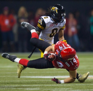 Calgary Stampeders' running back Matt Walter gets tackled by Hamilton Tiger-Cats' linebacker Rico Murray during the 102nd Grey Cup in Vancouver, B.C. Sunday, Nov. 30, 2014. The Toronto Argonauts signed veteran American linebacker-defensive back Rico Murray on Friday.The five-foot-11, 203-pound Murray spent the last four seasons with the Hamilton Tiger-Cats. THE CANADIAN PRESS/Darryl Dyck