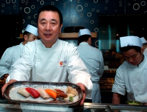 In this Jan. 10, 2007 file photo, celebrity Japanese chef Nobuyuki Matsuhisa shows off an assortment of sushi pieces he prepared for his new restaurant Nobu, at a press availability, in Hong Kong. The upmarket Japanese-fusion restaurant chain Nobu is expanding into Canada as part of a combination hotel and condo complex in Toronto. (AP Photo/Lo Sai-hung)