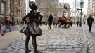 A statue titled 'Fearless Girl' faces the Wall Street bull, on March 8, 2017. (Mark Lennihan / AP)