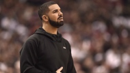 "Rapper Drake watches the action between the Indiana Pacers and the Toronto Raptors during first half NBA playoff basketball action in Toronto on Tuesday, April 26, 2016. Toronto hip hop star Drake will release a new project next weekend.The musician posted a promotional video on Instagram Saturday that said ""More Life"" is set to arrive on March 18. THE CANADIAN PRESS/Frank Gunn"