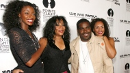"This Aug. 14, 2006 file photo shows Joni Sledge, one of the original members of ""Sister Sledge,"" second from left, posing with Rodney Jerkins, second from right, her niece Camille Sledge, left, and her cousin Amber Sledge at the ""We Are Family 2006 - All-Star Katrina Benefit CD and Documentary DVD Launch"" in Century City, Calif. Sledge, who with her sisters recorded the defining dance anthem ""We Are Family,"" has died, the band's representative says. She was 60. Sledge was found dead in her home by a friend in Phoenix, Arizona, on Friday, the band's publicist, Biff Warren, said Saturday, March 11, 2017. A cause of death has not been determined.  (AP Photo/Chris Polk, File)"