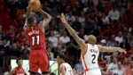 Toronto Raptors center Jonas Valanciunas (17) dunks against the Miami Heat during the first half of an NBA basketball game, Saturday, March 11, 2017, in Miami. (AP Photo/Alan Diaz)