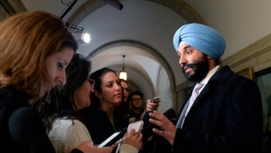 Minister of Innovation, Science and Economic Development Navdeep Bains speaks to reporters following a caucus meeting on Parliament Hill, in Ottawa on Wednesday, Feb. 8, 2017. (Justin Tang / THE CANADIAN PRESS)