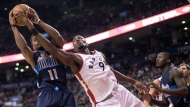 Dallas Mavericks guard Yogi Ferrell (11) takes a defensive rebound from Toronto Raptors forward Serge Ibaka (9) during first half NBA basketball action in Toronto on Monday, March 13, 2017. THE CANADIAN PRESS/Chris Young
