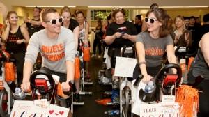 Dave Franco and Alison Brie ride at a Cycle for Survival event on Saturday, March 4, 2017, in Los Angeles. 100 percent of funds raised by Cycle for Survival go to groundbreaking rare cancer research led by Memorial Sloan Kettering Cancer Center. (Photo by Casey Rodgers/Invision for Cycle for Survival/AP Images)