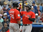 Boston Red Sox's Rusney Castillo, right, high fives teammate Rafael Devers after Castillo hit a home run off Toronto Blue Jays starting pitcher Mat Latos during the fifth inning of a spring training baseball game Monday, March 13, 2017, in Dunedin, Fla. (AP Photo/Chris O'Meara)
