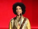 In this Nov. 22, 2015 file photo, Prince presents the award for favorite album - soul/R&B at the American Music Awards in Los Angeles. People magazine reported online on March 15, 2017, that Prince's ex-wife says is opening up about the couple's baby who died just six days after being born with a rare genetic disorder in 1996. Mayte Garcia writes in a new memoir that baby Amiir was born in Oct. 1996 with Pfeiffer syndrome type 2, a disorder that causes skeletal abnormalities. (Photo by Matt Sayles/Invision/AP, File)