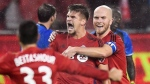 Toronto FC defender Nick Hagglund (6) celebrates his goal against the Montreal Impact with teammates Michael Bradley (4) and Steven Beitashour (33) during second half MLS Eastern Conference playoff soccer final action in Toronto on Wednesday, November 30, 2016. THE CANADIAN PRESS/Frank Gunn