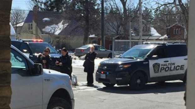 Police are seen in a commercial plaza on Plains Road East in Burlington where two people were reportedly shot on Thursday afternoon. (CTV News Toronto)