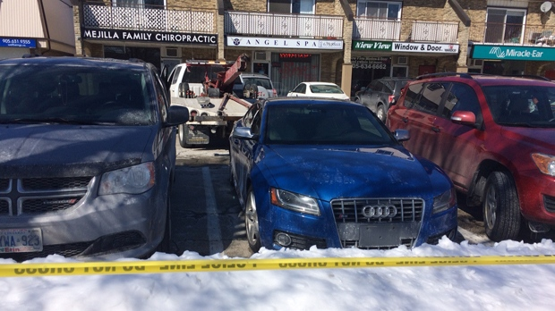 An Audi S5 coupe without license plates being towed from the scene of the shooting in Burlington on March 16. (Dave Roberts/CP24)