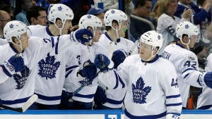 Toronto Maple Leafs defenseman Morgan Rielly (44) celebrates with the bench after scoring against the Tampa Bay Lightning during the second period of an NHL hockey game Thursday, March 16, 2017, in Tampa, Fla. (AP Photo/Chris O'Meara)