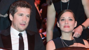 French actress Marion Cotillard sit with French actor and director Guillaume Canet at the 40th Cesar Film Awards at Theatre du Chatelet in Paris, France, Friday, Feb. 20, 2015. This annual ceremony is presented by the French Academy of Cinema Arts and Techniques. (AP Photo/Jacques Brinon)