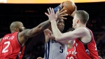 Detroit Pistons guard Kentavious Caldwell-Pope (5) tries to go to the basket against Toronto Raptors forward P.J. Tucker (2) and center Jakob Poeltl, right, during the first half of an NBA basketball game Friday, March 17, 2017, in Auburn Hills, Mich. (AP Photo/Duane Burleson)