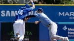 Toronto Blue Jays' Justin Smoak, left, is tagged out by Tampa Bay Rays shortstop Daniel Robertson, right, in the second inning of a spring training baseball game, Saturday, March 18, 2017, in Dunedin, Fla. (AP Photo/John Raoux)