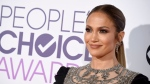 FILE - In this Jan. 18, 2017 file photo, Jennifer Lopez arrives at the People's Choice Awards at the Microsoft Theater, in Los Angeles. Back at spring training with the New York Yankees as a guest instructor, Alex Rodriguez watched part of an exhibition game against the Baltimore Orioles on Saturday, March 18, 2017 in a suite with singer-actress Jennifer Lopez. (Photo by Jordan Strauss/Invision/AP, File)