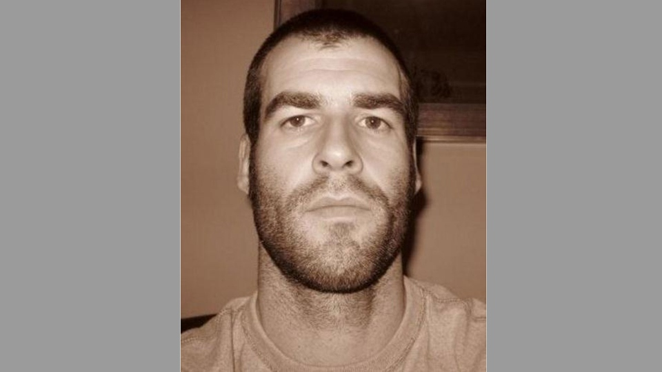 Justin Kuijer is pictured in this police handout photo.