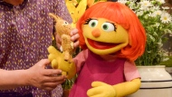 """This image released by Sesame Workshop shows Julia, a new autistic muppet character debuting on the 47th Season of """"Sesame Street."""" (Zach Hyman/Sesame Workshop via AP)"""