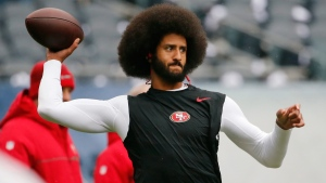 Colin Kaepernick warms up before an NFL football game against the Chicago Bears on Dec. 4, 2016. (Charles Rex Arbogast / AP)
