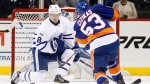 Toronto Maple Leafs defenceman Connor Carrick (8) defends in front of the Leafs' goal as New York Islanders center Casey Cizikas (53) takes a shot during the first period of an NHL hockey game in New York, Monday, Feb. 6, 2017. THE CANADIAN PRESS/AP/Kathy Willens