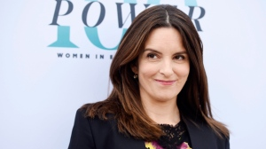 Tina Fey, recipient of the Sherry Lansing Leadership Award, poses at The Hollywood Reporter's 25th Annual Women in Entertainment Breakfast at MILK Studios on Wednesday, Dec. 7, 2016, in Los Angeles. (Photo by Chris Pizzello/Invision/AP)