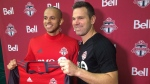 Newly-signed defender Jason Hernandez (left) poses with Toronto FC coach Greg Vanney in Toronto on Tuesday. (Neil Davidson/The Canadian Press)