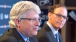 New Toronto Argonauts head coach Marc Trestman, right, listens as new general manager Jim Popp speaks during a press conference to announce their hirings in Toronto on Tuesday, February 28, 2017. THE CANADIAN PRESS/Frank Gunn