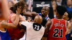 Toronto Raptors forward Serge Ibaka (9) lands a strike on Chicago Bulls center Robin Lopez (8) during a scuffle in second half NBA basketball action, in Toronto on Tuesday, March 21, 2017. THE CANADIAN PRESS/Frank Gunn