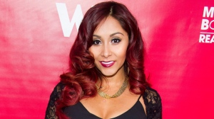 "In this May 29, 2014 file photo, Nicole ""Snooki"" Polizzi attends WE tv's ""Marriage Boot Camp: Reality Stars"" party in New York. Under legislation inspired by former ""Jersey Shore"" reality TV star Polizzi, no more than $10,000 of state money could go to pay speakers at New Jersey's public universities. The Democrat-controlled Assembly is scheduled to vote on the bill Thursday, March 23, 2017. (Photo by Charles Sykes/Invision/AP, FIle)"