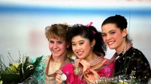 In this March 12, 1991, file photo, American skaters (L to R) Tonya Harding, silver; Kristi Yamaguchi, gold; and Nancy Kerrigan, bronze, display their medals after the finals of the World Figure Skating Championships in Munich. A run-of-the-mill good luck tweet from Yamaguchi to Kerrigan is drawing online attention. Yamaguchi tweeted a message to Kerrigan ahead of Kerrigan' performance on Monday'ÄúDancing with the Stars' March 20, 2017, and added 'Äúbreak a leg.' Kerrigan was hit in the leg before the 1994 Winter Olympics by a man hired by the ex-husband of Harding. Yamaguchi'Äôs spokeswoman says 'Äúno ill will was intended. (AP Photo/Diether Endlicher, File)