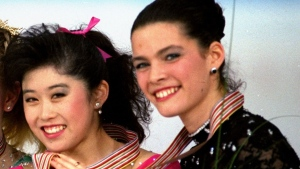 In this March 12, 1991, file photo, American skaters Kristi Yamaguchi and Nancy Kerrigan display their medals after the finals of the World Figure Skating Championships in Munich. (AP Photo/Diether Endlicher, File)