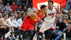 Toronto Raptors guard DeMar DeRozan (10) drives to the basket past Miami Heat guard Josh Richardson (0) in the second half of an NBA basketball game, Thursday, March 23, 2017, in Miami. Toronto won the game 101-84. (AP Photo/Joe Skipper)