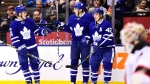 Toronto Maple Leafs left wing James van Riemsdyk (25) celebrates his goal against New Jersey Devils goalie Keith Kinkaid (1) with teammates Jake Gardiner (51) and Tyler Bozak (42) during second period NHL action in Toronto on Thursday, March 23, 2017. THE CANADIAN PRESS/Frank Gunn