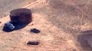 In this March 17, 2017, aerial photo released by the Arizona Department of Public Safety shows Amber VanHeckeher's vehicle of near the Grand Canyon in Arizona. The 24-year-old Texas college student was stranded for five days and had left signs on the car detailing where she was headed in search of cell phone signal, and rescuers eventually found her. (Arizona Department of Public Safety via AP)