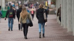 Students walk on the campus of the University of Guelph on Friday, March 24, 2017. (THE CANADIAN PRESS / Hannah Yoon)