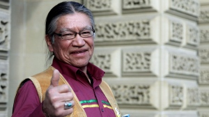 Edmund Metatawabin, who attended St. Anne's Indian residential school in Fort Albany, Ont., is seen outside court in Toronto on Wednesday. Metatawabin and others who went to the notorious school are fighting for compensation for the abuse they say they suffered. (Colin Perkel/The Canadian Press)