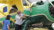 In this July 28, 2016, file photo, Harrison Ford opens the door on his plane for Jodie Gawthorp, of Westchester, Ill., who was selected to fly with Ford, at the Experimental Aircraft Associations AirVenture air show at Wittman Regional Airport in Oshkosh, Wis. Ford told an air traffic controller he was distracted and concerned about turbulence from another aircraft when he mistakenly landed his small plane on a taxiway at a Southern California airport in Feb. 2017. (Joe Sienkiewicz/The Oshkosh Northwestern via AP, File)