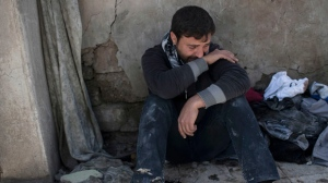 Ahmed Pesher cries next to the destroyed houses where he says 23 members of his family were killed during fights between Iraq security forces and Islamic State on the western side of Mosul, Iraq, Friday, March 24, 2017. Residents of the Iraqi city's neighborhood known as Mosul Jidideh at the scene say that scores of residents are believed to have been killed by airstrikes that hit a cluster of homes in the area earlier this month (AP Photo/Felipe Dana)