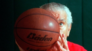 In this 1995 photo, Dr. Tom Amberry goes through his workout in Seal Beach, Calif. Amberry, who made history when he shot 2,750 consecutive free throws, has died. He was 94. Amberry died in Long Beach, Calif., on March 18, said his daughter, Roxanne Amberry. The retired podiatrist earned a spot in Guinness World Records and brief celebrity in 1993 after he lobbed in shot after shot for 12 hours. (Con Keyes/Los Angeles Times via AP)
