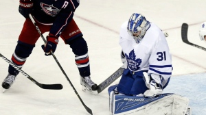 Toronto Maple Leafs goalie Frederik Andersen, right, of Denmark, stops a shot by Columbus Blue Jackets forward Boone Jenner during the third period of an NHL hockey game in Columbus, Ohio, Wednesday, March 22, 2017. The Maple Leafs won 5-2. (AP Photo/Paul Vernon)