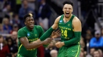 Oregon guard Dylan Ennis, left, celebrates with teammate Dillon Brooks at the end of the Midwest Regional final against Kansas in the NCAA men's college basketball tournament, Saturday, March 25, 2017, in Kansas City, Mo. Oregon won 74-60. (AP Photo/Charlie Riedel)